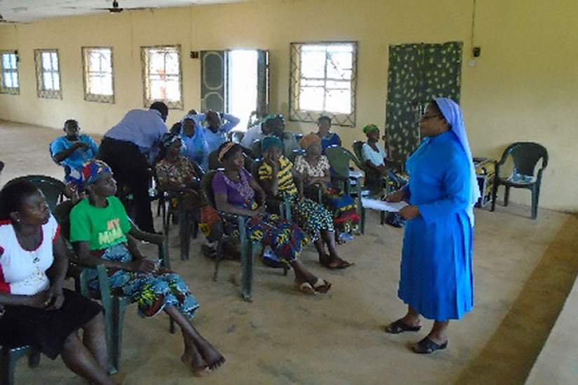 Sr. Veronica addressing beneficiaries on economic empowerment.