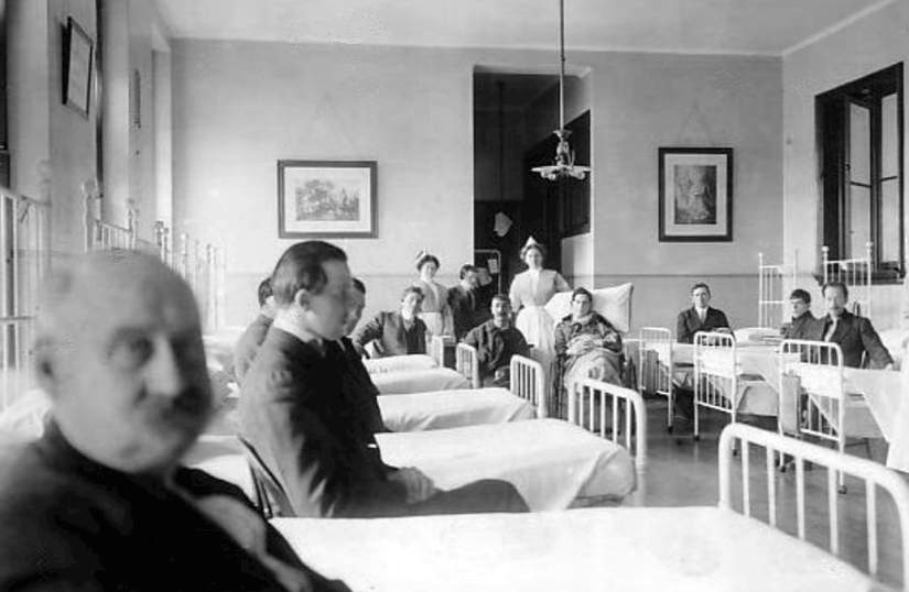 Photo of some Titanic survivors recovering at St. Vincent's Hospital in New York City. The two men with the nurse in the background are Titanic crew members. The man with the pillow behind him is Thomas Whitely, who was a waiter on the ship. He suffered a broken leg and burns. To his right is John Thompson, who was a fireman on the Titanic; Thompson suffered a broken arm. (Source)