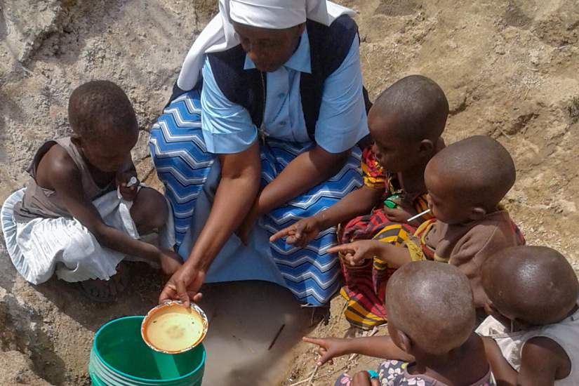 While traveling, Sr. Benedicta takes the time to educate young children about the importance of clean water and how to collect it.