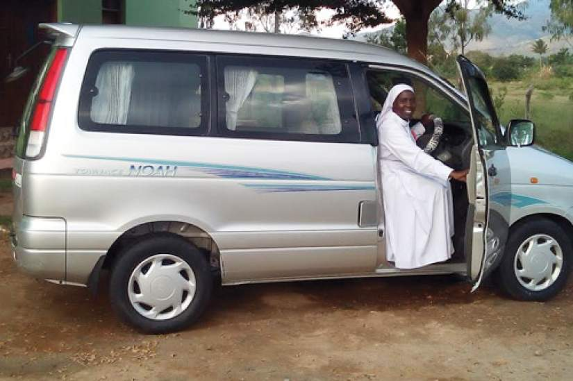 Sr. M. Tryphina Buchard, STH, ASEC Director in Tanzania, behind the wheel of her van.