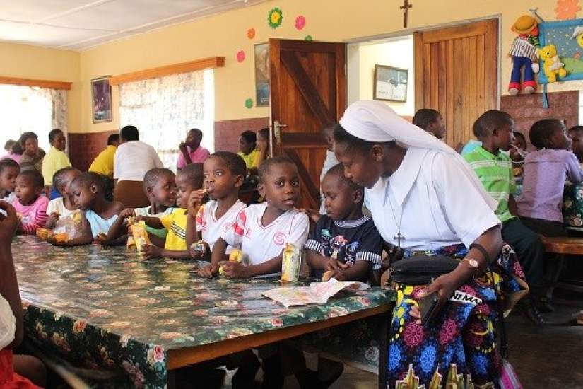 Sr. Teresa Mulenga, TS, ASEC Programs Coordinator in Malawi, working with children.
