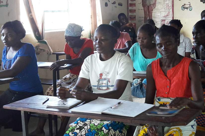 Sr. Judith Mwango with students from the adult literacy class, consisting of 34 adults not ashamed to go back to school to attain an education.