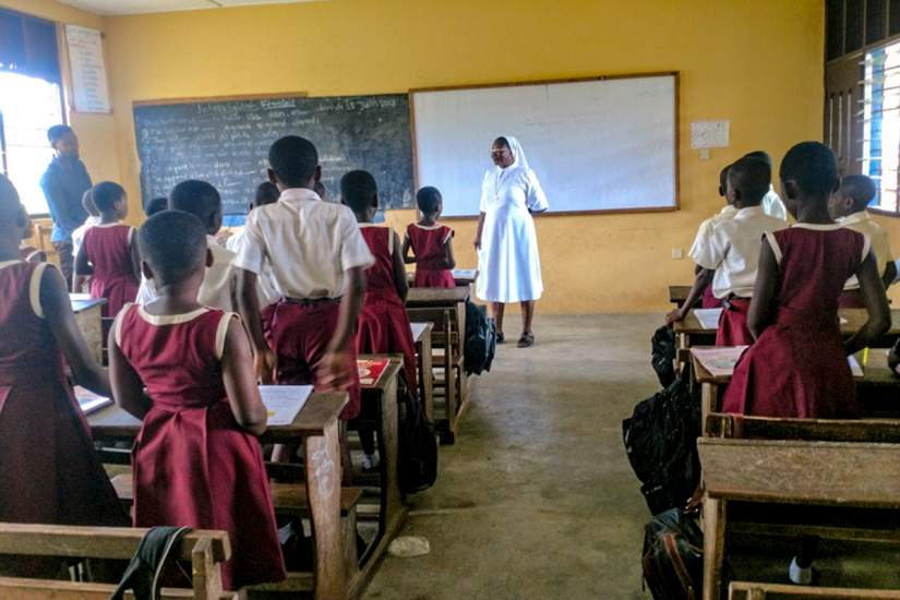 A Society of Jesus (SIJ) sister teaches young students of Infant Jesus Preparatory school in Twifo Praso, Ghana.