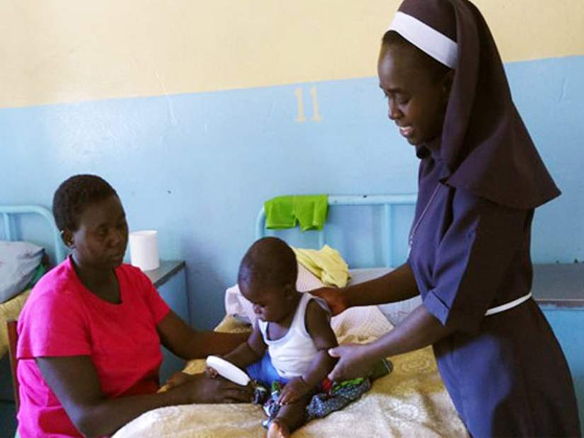 Sr. Constancia caring for a young child at the clinic.