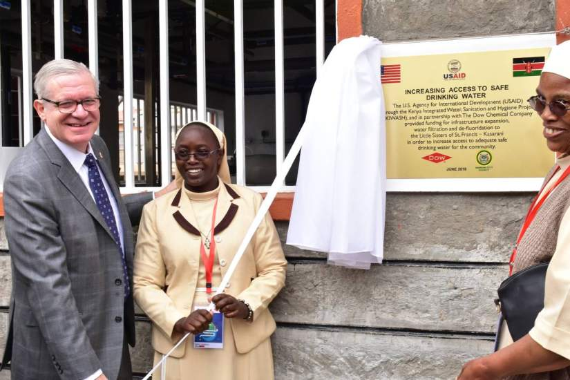 Sr. Esther (left) stands with the U.S. Under Secretary of Commerce, Gilbert Kaplan and a fellow sister at the official opening of the Water Purification Plant.
