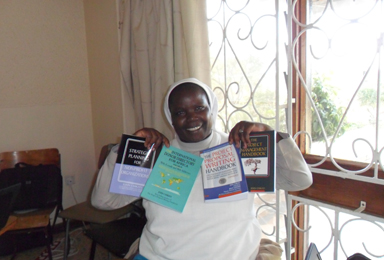 Sr.-Zavero-Beatrice-Karimi-posing-with-her-text-books