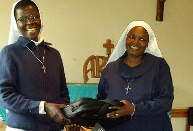 Sr.-Miilka-receiving-her-laptop