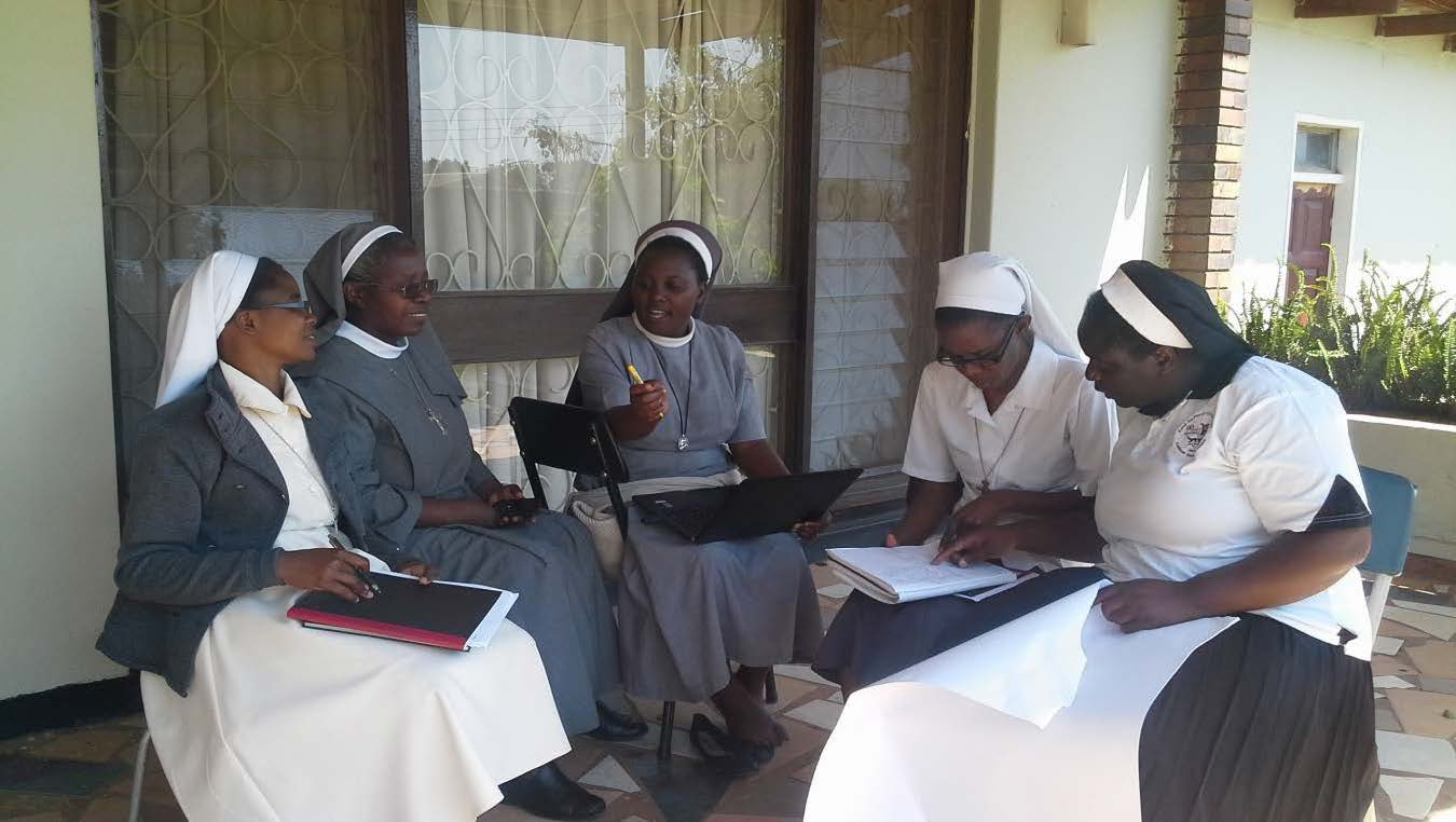 Sisters engage in group work during an Administration workshop in Zambia in 2015.