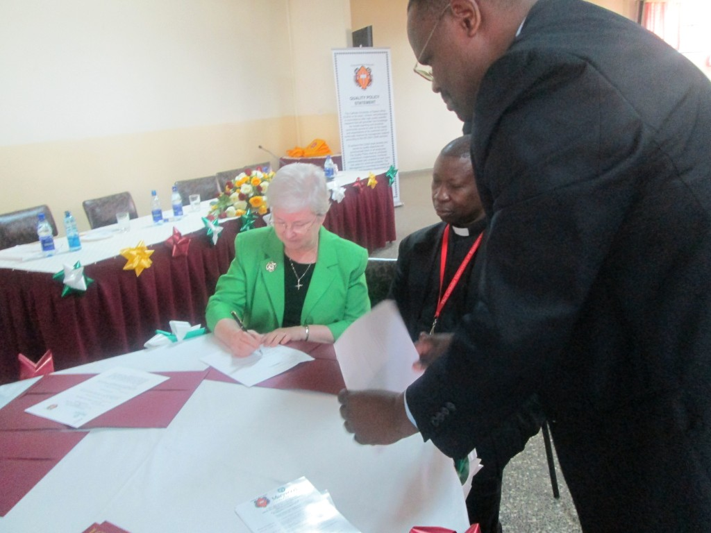 Sr. Anne Munley, IHM, Ph.D. together with Reverend Dr. Pius Rutechura, Vice Chancellor of the Catholic University of Eastern Africa (CUEA), signing the MOU
