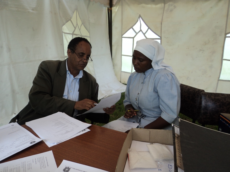 Sr. Mary Annet signs her bridge course agreement May 2013