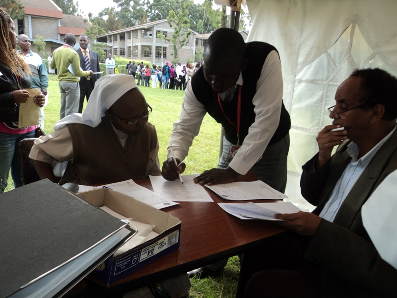 Sr. Mary Rose signs her bridge course agreement May 2013