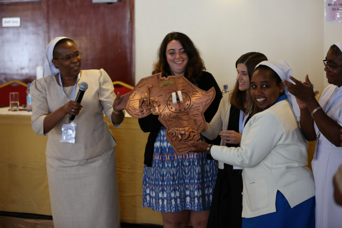 ASEC staff receiving a gift from Sisters in Africa in honor for the services provided to them.