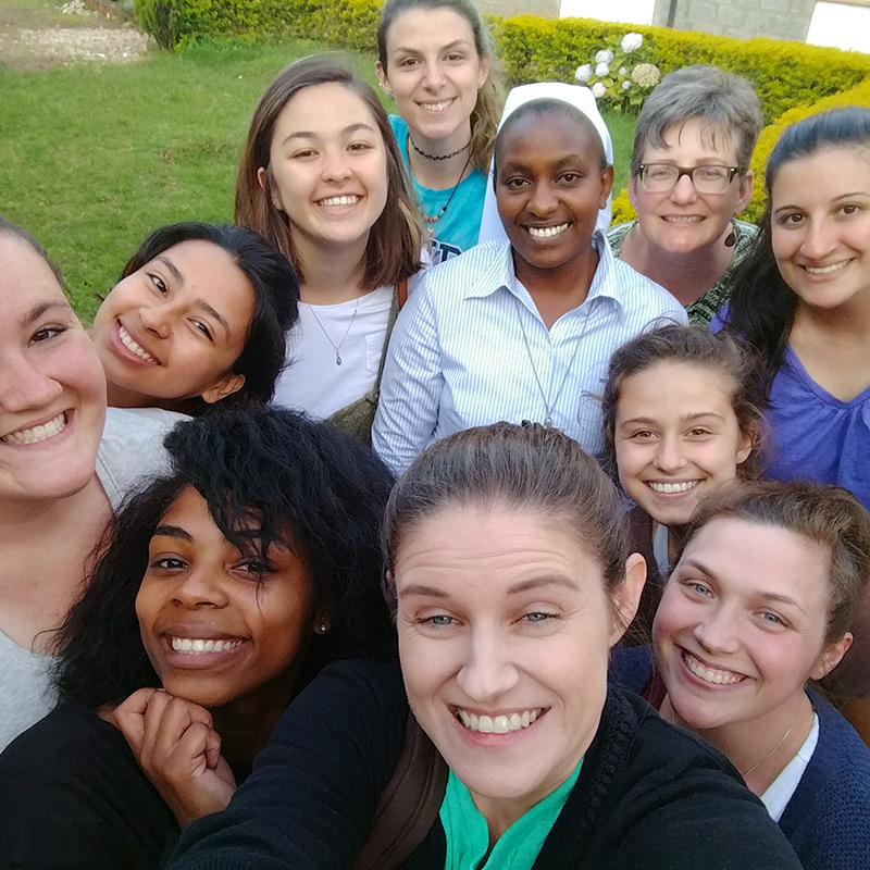 Service Learning trip students and mentors with Sr. Ann at Cheshire Home in Limuru, Kenya.